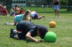 Now that's using your head. Nic Schremp, a student at Lanigan Elementary School, uses only his head to move a kick ball through a relay course at the school's annual game day.