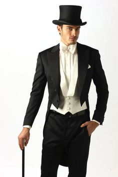 For that traditional groom... Archetipo tailcoat. And a top hat if he feels like it!