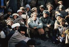 Afghan guerrilla leader, Ahmad Shah Massoud, center, is surrounded by Mujahideen commanders at a meeting of the rebels in the Panchir Valley...