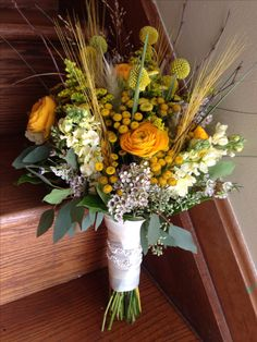 Rustic fall bridal bouquet on creams and yellows  www.myfloralimpressions.net Follow us on Facebook