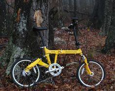 "Full suspension 20"" wheel folding bike in the woods"