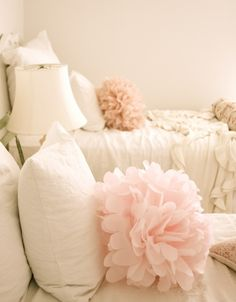 I hope I have at least one girl do I can decorate her room like this... Pale pinks, ruffled pillows