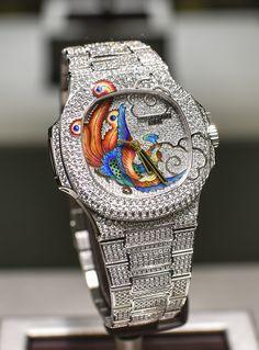 Patek Philippe [NEW] Nautilus 5720/2G White Gold Diamond Bird Dial at HK$3,300,000. #pp #patekphilippe #5720/2G #5720-2G #PatekBird #ppbird #patekphilippebird #5720_2G