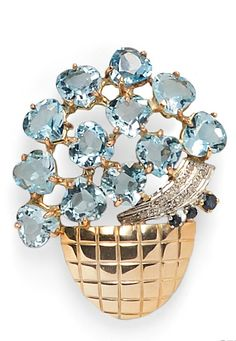 14kt Gold and Blue Topaz Brooch, designed as a flower basket with pear-shape topaz blossoms, circular-cut sapphire and diamond melee accents, 1 1/2 x 2 in.
