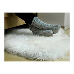 Extremely comfortable 100% real sheepskin.