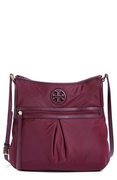 Free shipping and returns on Tory Burch Nylon Swingpack at Nordstrom.com. With its sport-inspired silhouette, durable webbed strap and nylon construction, this swingpack from Tory Burch is sure to become a go-to favorite in your collection. Perfect for around-town errands, this crossbody bag features a deep exterior zip pocket for keeping necessary items close at hand, as well plenty of interior pockets—making on-the-go organizing a breeze.