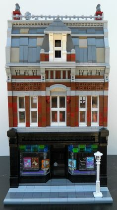Inspired by Victorian buildings in Montreal. My newest modular is a with a bookstore on the first floor and a two bedroom apartment on the upper two floors. Lego Modular, Lego Bedroom, Bedroom Apartment, Bedroom Kids, Bedroom Furniture, Lego Hacks, Casa Lego, Lego Minifigure Display, Lego Display