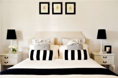 black and white bedding with natural upholstered headboard