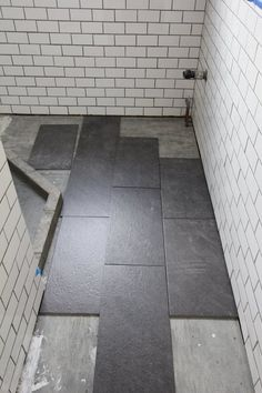 Staggered slate gray floor tiles, white matte subway tile w gray grout.    For my bathroom renovation, I finally decided on large slate tiles for the bathroom floor