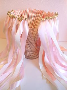 Wedding Wands -ribbon with a bell on the ends for guests to use instead of bubbles or rice etc.