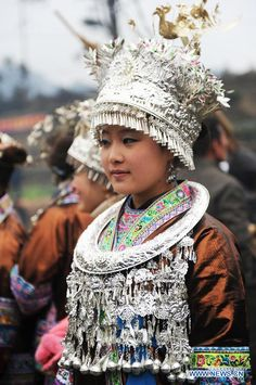A traditionally dressed woman of Miao ethnic group takes part in the 'Pohui', a big party event participated by local people to celebrate Chinese lunar new year, in Yuanbao Village of Antai Township, Rongshui Miao Autonomous County, south China's Guangxi Zhuang Autonomous Region, Feb. 10, 2014. The 'Pohui', which has a history of more than 100 years, is annually held from the first day to the 17th day of the first month on the Chinese lunar calendar. (Xinhua/Li Bin)