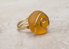 Orange Sea Glass Ring: Gold Wire Wrapped Tangerine Tango Beach Jewelry, Size 7 from SherryKayDesigns on Etsy. Saved to Tangerine. Sea Glass Ring, Sea Glass Jewelry, Beach Jewelry, Gold Wire, Jewelery, Handmade Jewelry, Gemstone Rings, Jewelry Making, Silver Rings