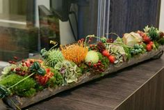 Inspiration for a buffet! Mix food in with floral line-up.