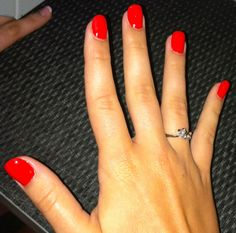 """Cajun Shrimp"" by OPI.                                   Oval shaped nails"