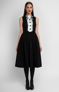 Sleeveless black wool dress. Round neck decorated with a designer handmade true silk rose. Placket with idle buttons and silk jabot. Hidden back zip closure. Side seam pockets. #Pintel #work #cocktail #black #white #red #wool #silk  #dress #cute #pretty #midi #handmade #rose