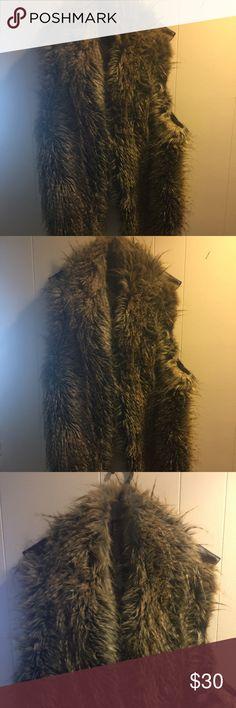 Faux fur Sexy faux fur vest for sale good condition must go!!! Ashley Stewart Jackets & Coats Vests