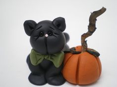 Black Halloween Cat with Pumpkin - Polymer clay by Helens Clay Art via Etsy
