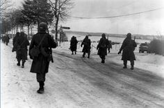 The 101st Airborne troops move out of Bastogne, after having been besieged there for ten days, to drive the enemy out of the surrounding district. Belgium 12/31/44.