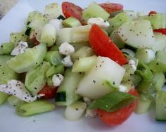 Greek Cucumber Summer Salad - something like this.  Cucumbers, Tomatoes, Kalamata Olives , Red onion, Feta cheese, maybe Parmesan cheese too.  Add pasta to make the kids happy.  With cucumber herb vinaigrette (also posted on this board). Yum!