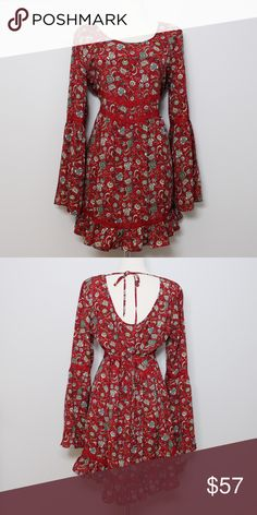 """Band of Gypsies Red Boho Dress with Bell Sleeves Bust: approx. 21"""" Length: approx 34"""" (shoulder to hem)  A super chic boho dress with bell sleeves and a floral pattern. The perfect fall dress to wear with your favorite boots! Ties from the back at across the top and the waist. No holes, stains or imperfections. Comes from a smoke free environment.  📦Bundles welcome 👌🏻Offers welcome through offer button. ❌NO trades, please. ⚡️Same/Next day shipping Band of Gypsies Dresses"""