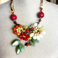 Third artist of #creativejumpstart, Frida Kahlo.  I haven't made any jewelry in awhile, so I was inspired to make a Frida-esque necklace from semi-precious stones reminiscent of her floral headpieces.  The chain is woven with a silk ribbon, a reference to the ribbons that she would work into her braided hair. #fridakahloinspired #floralnecklace #semipreciousstones