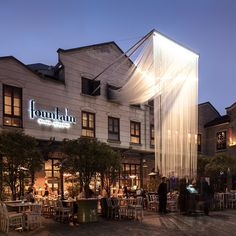30,000 meters of translucent cord spill from the upper windows of the fountain restaurant in, shanghai's xintiandi district, for RIBA's windows project 2015.