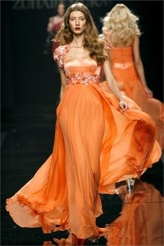 Fresh tangerine orange chiffon gown with tonal dimensional petals covering cap sleeves and wide empire waist. By Zuhair Murad 2009/2010 Ready-To-Wear