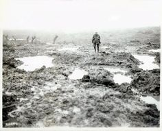 Canadian soldier standing in the mud of the battlefield of Passchendaele, 1917
