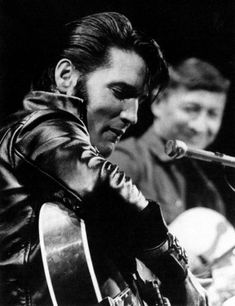 Elvis Presley:1968 Comeback Special. Killer, killer, killer. Drop dead sexy every time he laughed. I get it.