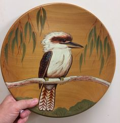 Wooden plate with painted decoration of a Kookaburra by Bill-Lin 'Wirrin' Onus, Penunga, Australia