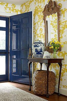 love the laquered blue door against the wallpaper... via  Zillow Digs