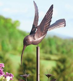 Bring color and motion to your yard with Wind Spinners in all sizes, colors and designs. Get your new wind spinner, garden whirligig or garden spinner here. Outdoor Art, Outdoor Life, Outdoor Gardens, Outdoor Living, Outdoor Stuff, Outdoor Spaces, Garden Wind Spinners, Wind Sculptures, Hummingbird Garden