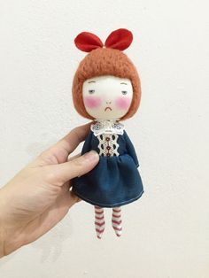 Handmade doll with red bow on head