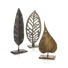 Decorate your tabletop, mantel or  floor with sculptures from Crate and Barrel. Shop glass, ceramic, metal, wood and wire sculptures and order online.