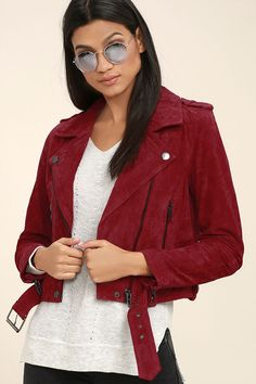 Having a moto moment? Then you won't want to pass up the Blank NYC Backhanded Red Suede Moto Jacket! Genuine suede leather is adorned in gunmetal zippers and snaps along the collared neckline, long sleeves, and belted hem. Two functioning zipper pockets frame an asymmetrical front zipper, while shoulder epaulettes, and a snap button pocket add classic moto details.
