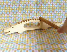 Alligator Percussion Instrument: a good alternative to a tambourine.