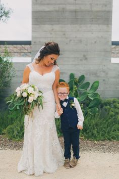 Adorable ring bearer, wedding style, navy blue boys' suit, vest, black bowtie // Lindsey Gomes Photography