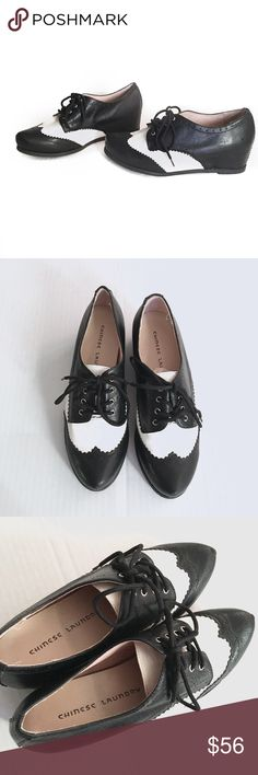 """Chinese Laundry Oxford Wingtip Wedges Funky/retro Chinese Laundry Oxford Wingtip tie Wedges // Sz 7 // black and white in color // slightly pointy toe // looks like they were worn once or twice // no material listed // no blemishes except for one marking on the right shoe, as shown // wedge is around 1.5"""" // interior markings are different. One says 7 and the other 7.5 // bottom stickers both show Sz 7 // sole measurements on both shoes are the same, so my best guess is that it is a size 7…"""