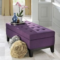 Want this at the end of my bed. Then I will have no room to walk thru there... baby look it matches our room!!!