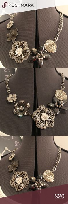 Fun necklace Where this gem to  dress up just about anything! Mixed metal flowers with rhinestones and black shiny onyx like beads Jewelry Necklaces