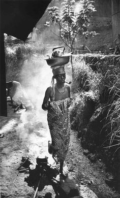A woman bringing food to her husband in Gabon by W. Eugene Smith [1302 x 2156]