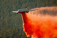 Tanker Air Carrier, a DC-10 jet converted to a firefighting aircraft, drops Phos-Check fire retardant. Photo by: David McNew | Getty Images