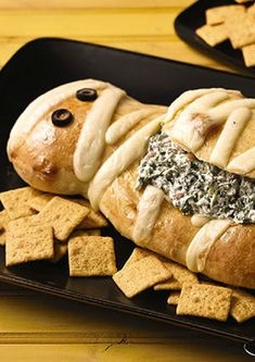 Halloween Mummy Spinach Dip – Bake this fun mummy-shape bread loaf as an appetizer, and you can be sure this spinach dip will win for Best Costume at your next Halloween party.
