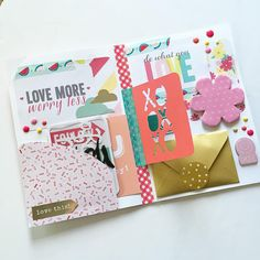 Like that journaling card hanging from the middle of the page with washi tape.