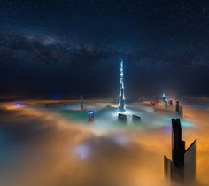 Dubai Galactica - Daniel Cheong Needless to say that this is a photo montage. It is a composite of a fog shot I took in Dubai from the Index Tower in May, and a Milky Way shot I took in Reunion Island in July this year. Night Clouds, Hotel Secrets, Dubai Skyscraper, Cloud Photos, Light Pollution, Belle Villa, Above The Clouds, Mauritius, Milky Way