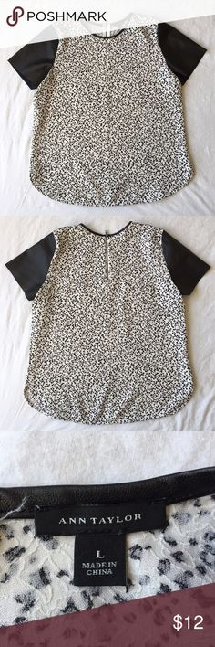 """.Ann Taylor. Black and white top Black and white Ann Taylor top with vegan leather details. Main portion of shirt has a crinkly texture and has white background with black """"confetti"""". Sleeves and collar vegan leather. Zipper in the back. There are a couple faint white lines on one sleeve - creases? This top could work at the office or on the weekend. Ann Taylor Tops Tees - Short Sleeve"""
