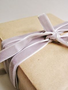 grey velvet ribbon on brown paper...gift wrap