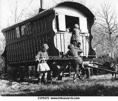 Gypsy children playing outside their caravan