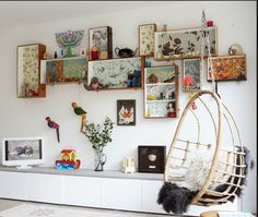 Eclectic white living room Using a mix of floral wallpapers, old drawers from salvaged furniture, have been given a new lease of life, mounted on the walls to create an eclectic display. The hanging chair adds a relaxed, vibe to the room. Simple Living Room, Eclectic Living Room, Living Room White, Modern Living, Box Shelves, Drawer Shelves, Wall Shelves, Wall Storage, Storage Cubes