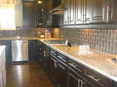 image result for grey backsplash tiles with red kitchen and granite countertops